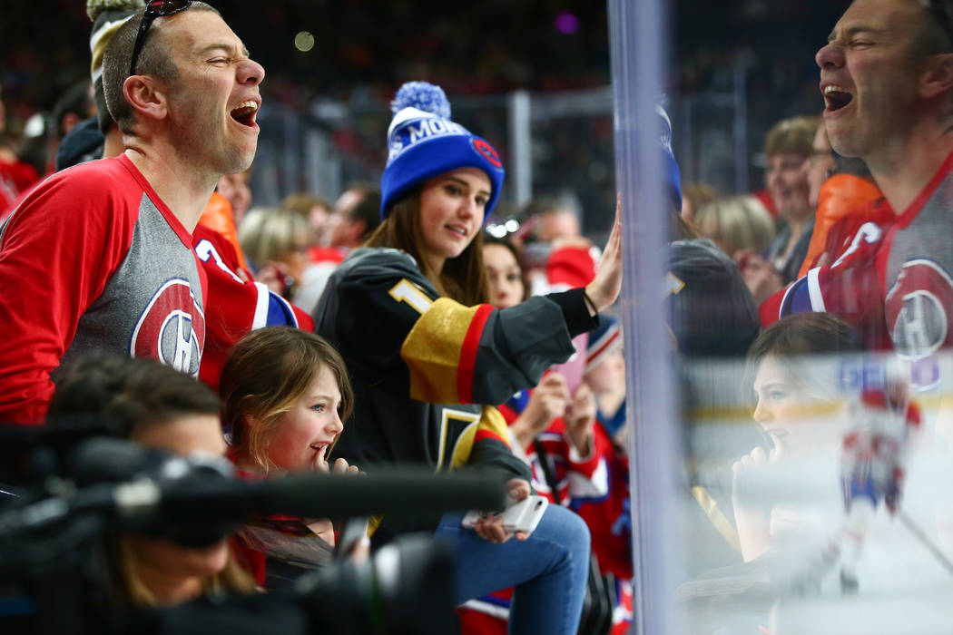 Hockey fans at the glass as teams warm up before an NHL hockey game between the Golden Knights and Montreal Canadiens at T-Mobile Arena in Las Vegas on Saturday, Feb. 17, 2018. Chase Stevens Las V ...