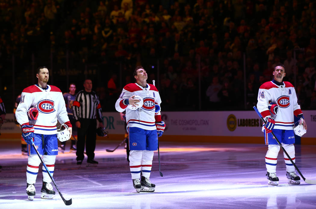 """Montreal Canadiens players stand for """"O Canada,"""" the Canadian National Anthem, before the start of an NHL hockey game at T-Mobile Arena in Las Vegas on Saturday, Feb. 17, 2018. C ..."""