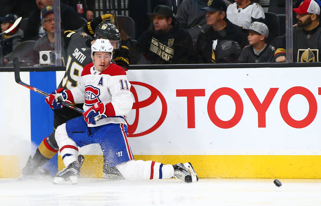 Montreal Canadiens right wing Brendan Gallagher (11) defends against Golden Knights right wing Reilly Smith (19) during the first period of an NHL hockey game at T-Mobile Arena in Las Vegas on Sat ...