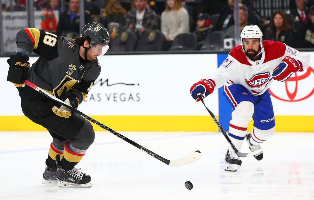 Golden Knights left wing James Neal (18) moves the puck as Montreal Canadiens defenseman David Schlemko (21) defends during the first period of an NHL hockey game at T-Mobile Arena in Las Vegas on ...