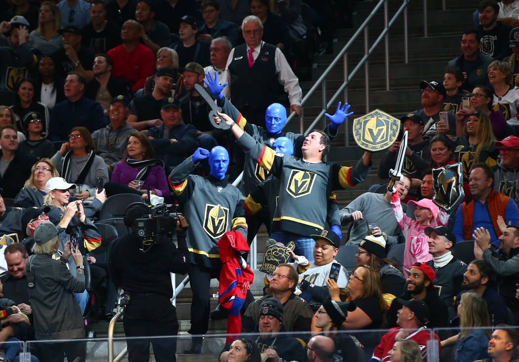 Members of the Blue Man Group entertain fans during the first period of an NHL hockey game between the Golden Knights and Montreal Canadiens at T-Mobile Arena in Las Vegas on Saturday, Feb. 17, 20 ...
