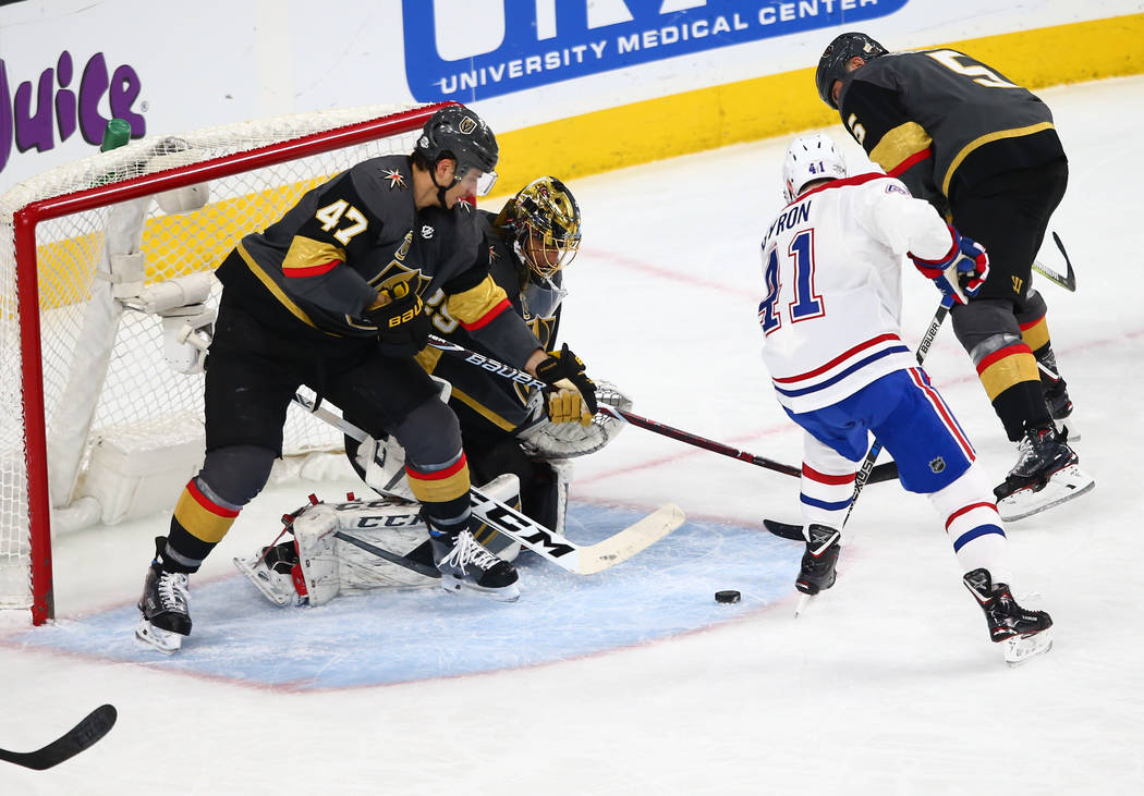 Golden Knights goaltender Marc-Andre Fleury (29) and Golden Knights defenseman Luca Sbisa (47) work to defend against Montreal Canadiens left wing Paul Byron (41) during the second period of an NH ...
