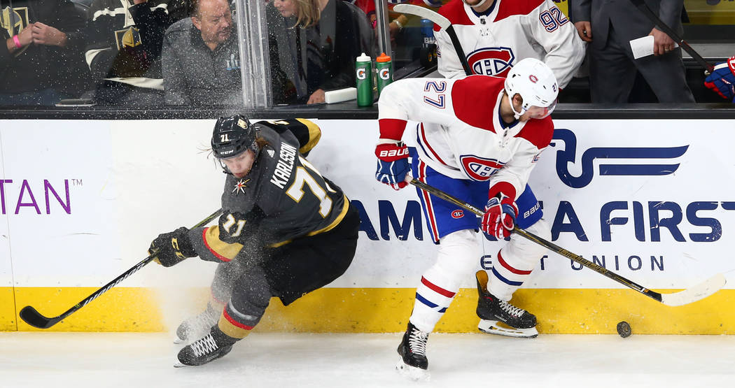 Montreal Canadiens left wing Alex Galchenyuk (27) moves the puck against Golden Knights center William Karlsson (71) during the second period of an NHL hockey game at T-Mobile Arena in Las Vegas o ...