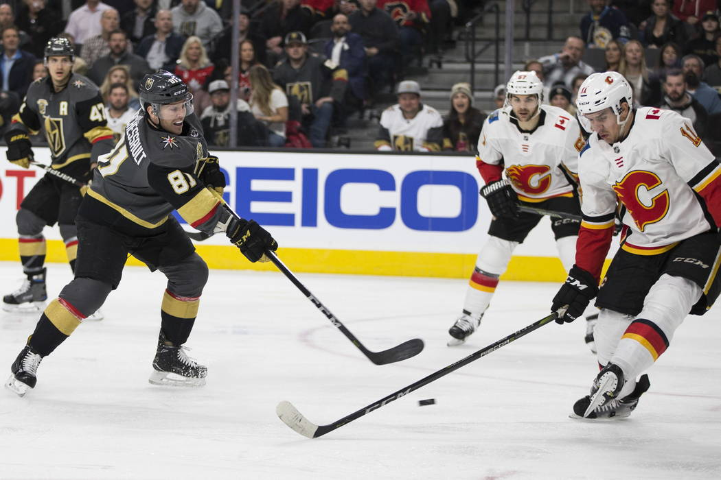 Vegas Golden Knights center Jonathan Marchessault (81) shoots the puck against Calgary Flames center Mikael Backlund (11) during the first period of an NHL game  at T-Mobile Arena in Las Vegas, We ...