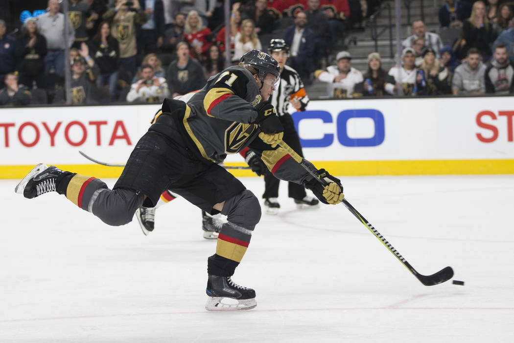 Vegas Golden Knights center William Karlsson (71) shoots the puck against Calgary Flames during the first period of an NHL game  at T-Mobile Arena in Las Vegas, Wednesday, Feb. 21, 2018. Erik Verd ...