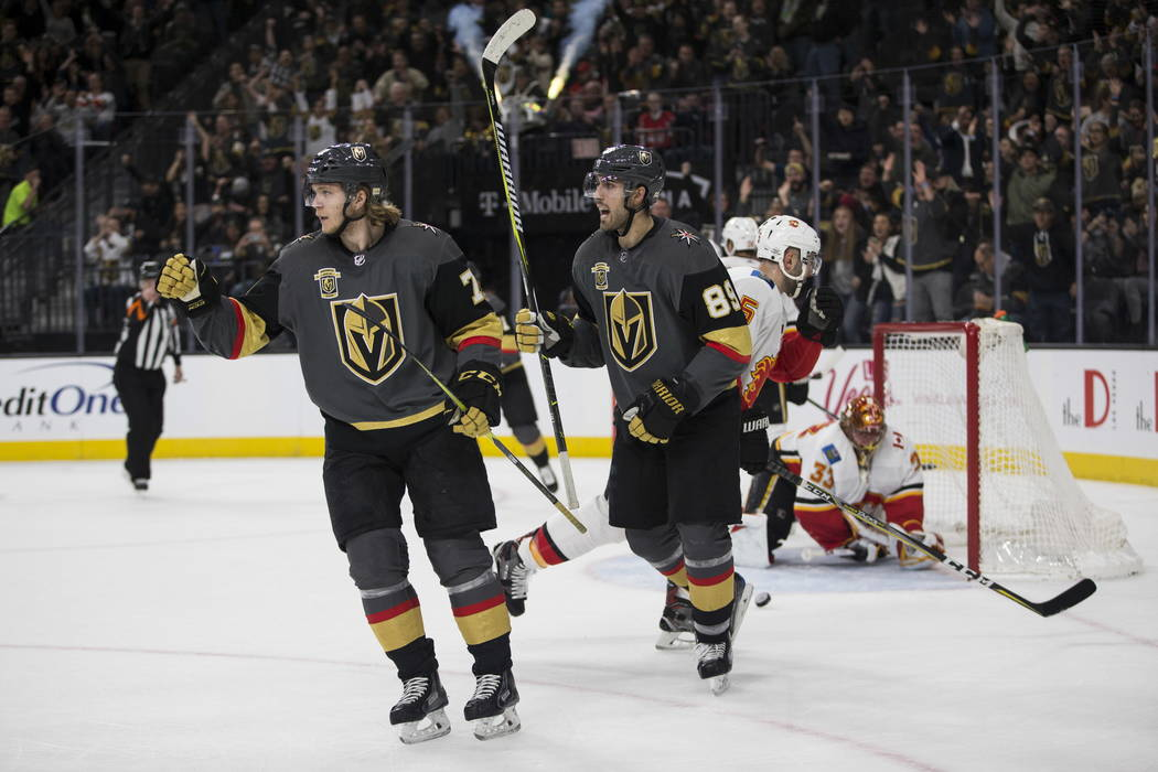 Vegas Golden Knights center William Karlsson (71) celebrates his score with right wing Alex Tuch (89) during the first period of an NHL game  at T-Mobile Arena in Las Vegas, Wednesday, Feb. 21, 20 ...