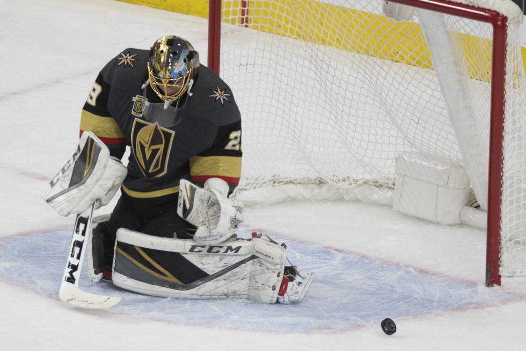 Vegas Golden Knights goaltender Marc-Andre Fleury (29) deflects a shot against Calgary Flames during the second period of an NHL hockey game at T-Mobile Arena in Las Vegas, Wednesday, Feb. 21, 201 ...