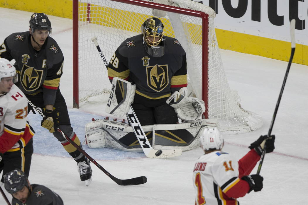 Vegas Golden Knights goaltender Marc-Andre Fleury (29) defends a shot by Calgary Flames center Mikael Backlund (11) during the second period of an NHL hockey game at T-Mobile Arena in Las Vegas, W ...