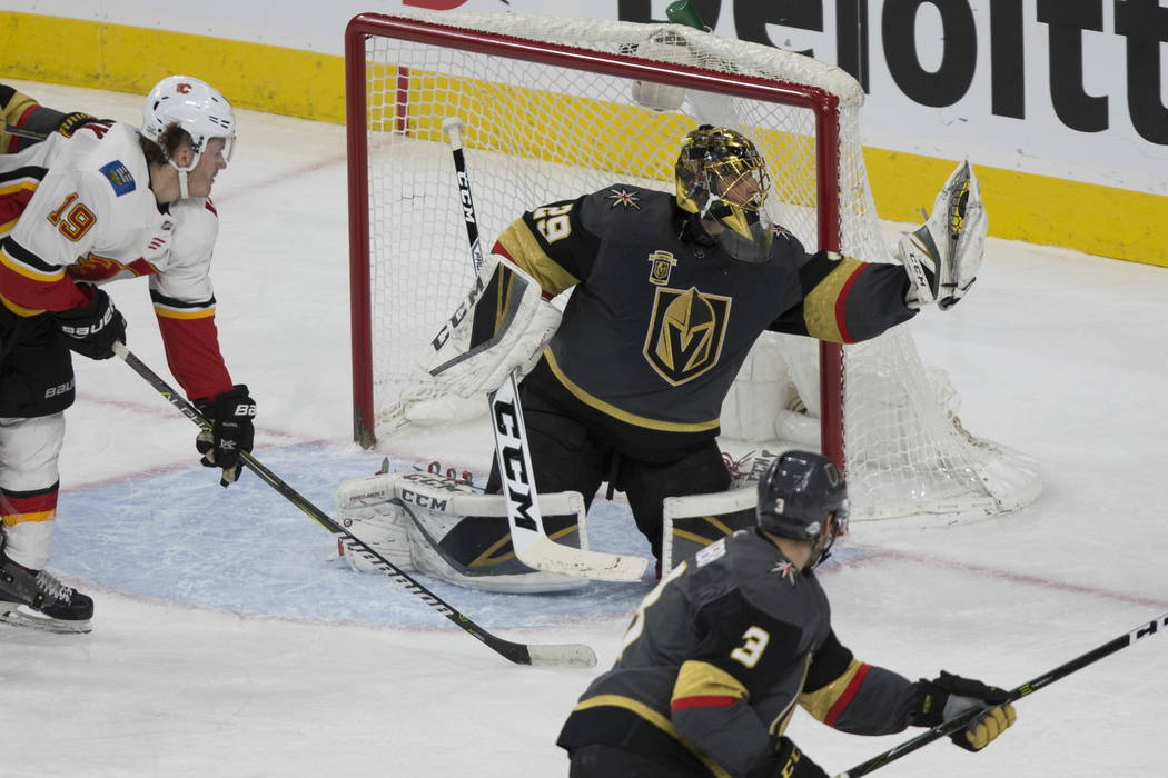 Vegas Golden Knights goaltender Marc-Andre Fleury (29) makes a stop against Calgary Flames during the second period of an NHL hockey game at T-Mobile Arena in Las Vegas, Wednesday, Feb. 21, 2018.  ...