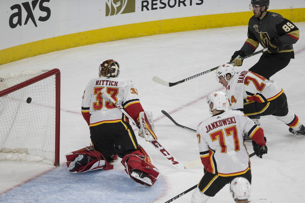 Vegas Golden Knights right wing Alex Tuch (89) scores a goal against Calgary Flames during the second period of an NHL hockey game at T-Mobile Arena in Las Vegas, Wednesday, Feb. 21, 2018. Erik Ve ...