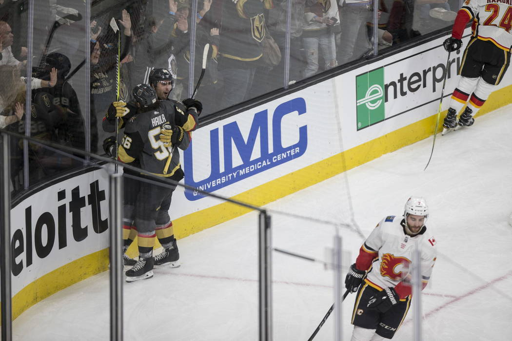Vegas Golden Knights right wing Alex Tuch (89) celebrates a score with left wing Erik Haula (56) against Calgary Flames during the second period of an NHL hockey game at T-Mobile Arena in Las Vega ...