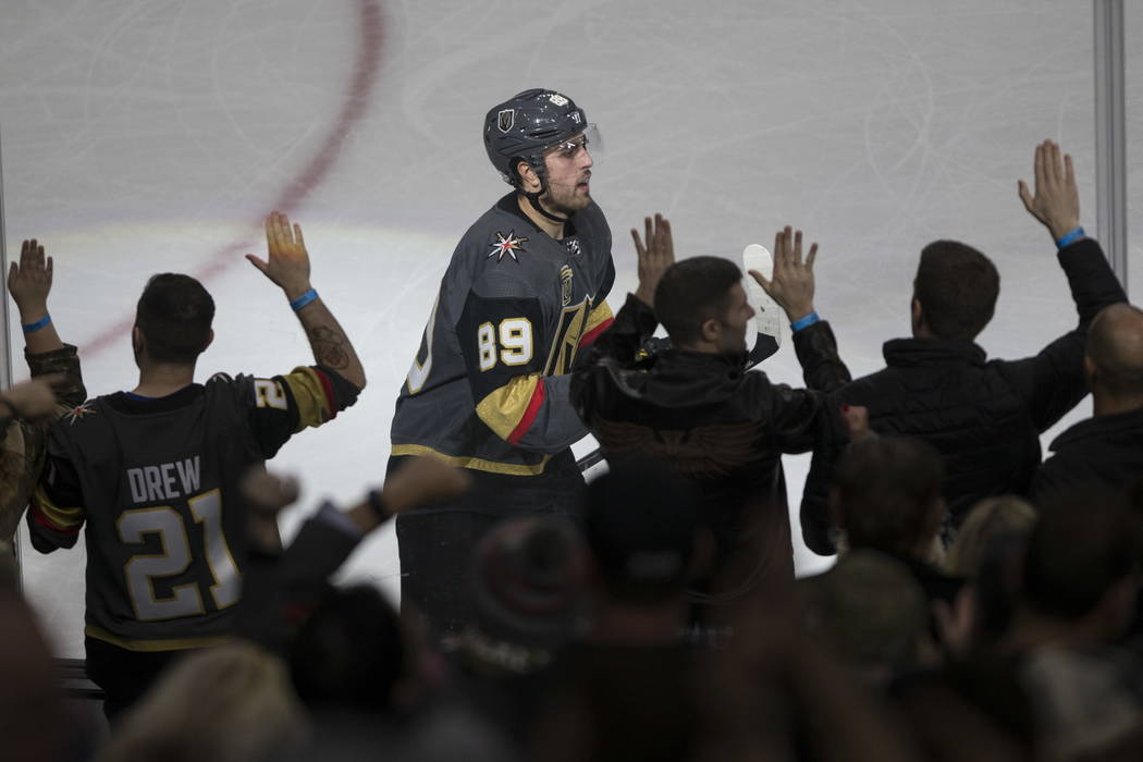 Vegas Golden Knights right wing Alex Tuch (89) celebrates a score against Calgary Flames during the second period of an NHL hockey game at T-Mobile Arena in Las Vegas, Wednesday, Feb. 21, 2018. Er ...