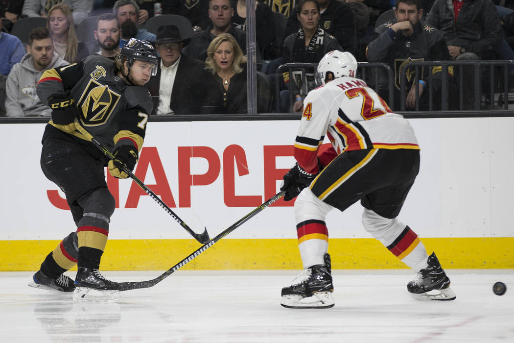 Vegas Golden Knights center William Karlsson (71) shoots the puck against Calgary Flames defenseman Travis Hamonic (24) during the third period of an NHL game at T-Mobile Arena in Las Vegas, Wedne ...