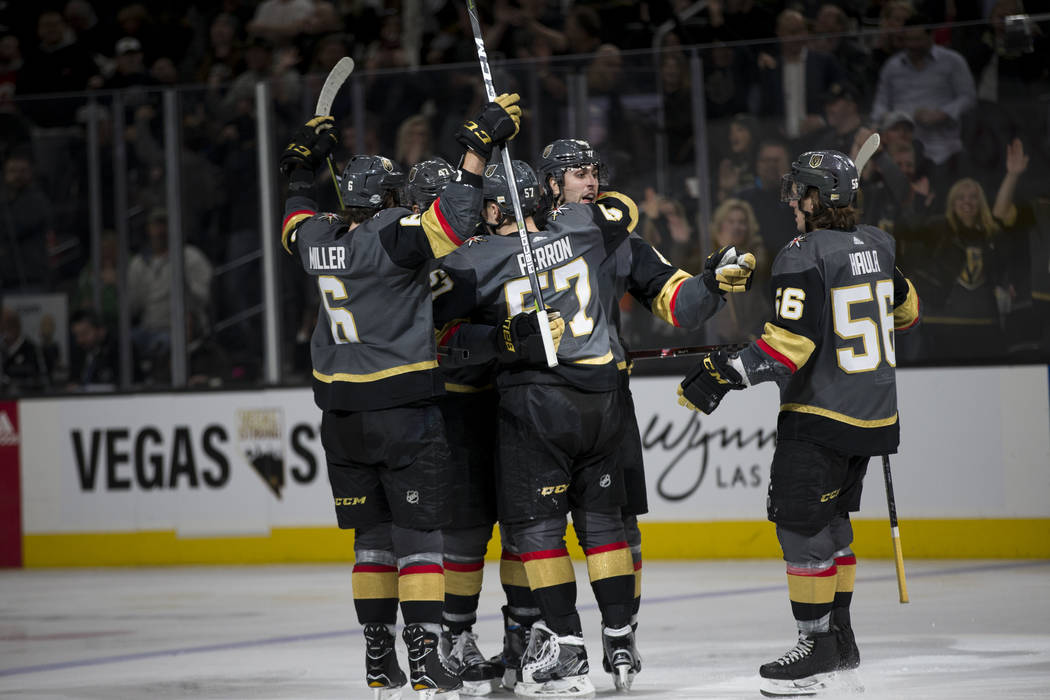 Vegas Golden Knights right wing Alex Tuch (89) celebrates his goal with defenseman Colin Miller (6), left wing David Perron (57) and left wing Erik Haula (56) during the third period of an NHL gam ...