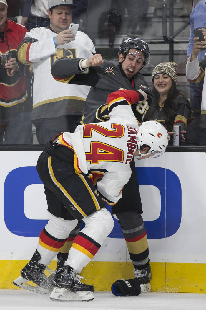 Vegas Golden Knights right wing Alex Tuch (89) fights Calgary Flames defenseman Travis Hamonic (24) during the third period of an NHL game at T-Mobile Arena in Las Vegas, Wednesday, Feb. 21, 2018. ...