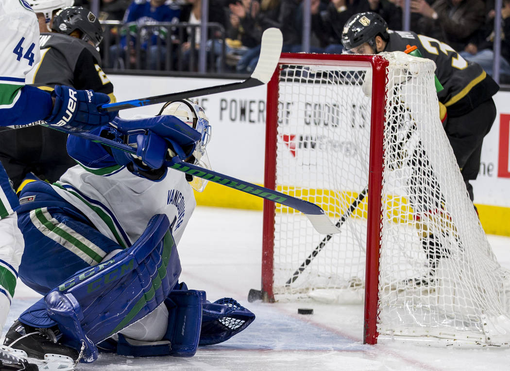 Vancouver Canucks goaltender Anders Nilsson (31) watches as the puck goes in, scored by Golden Knights right wing Tomas Hyka (38), during the first period of an NHL hockey game at T-Mobile Arena i ...