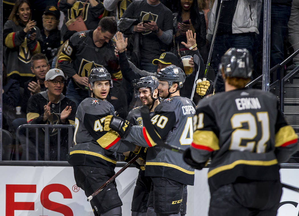 Golden Knights players celebrate after Vegas Golden Knights right wing Tomas Hyka (38) scored the first goal of the game during the first period of an NHL hockey game at T-Mobile Arena in Las Vega ...