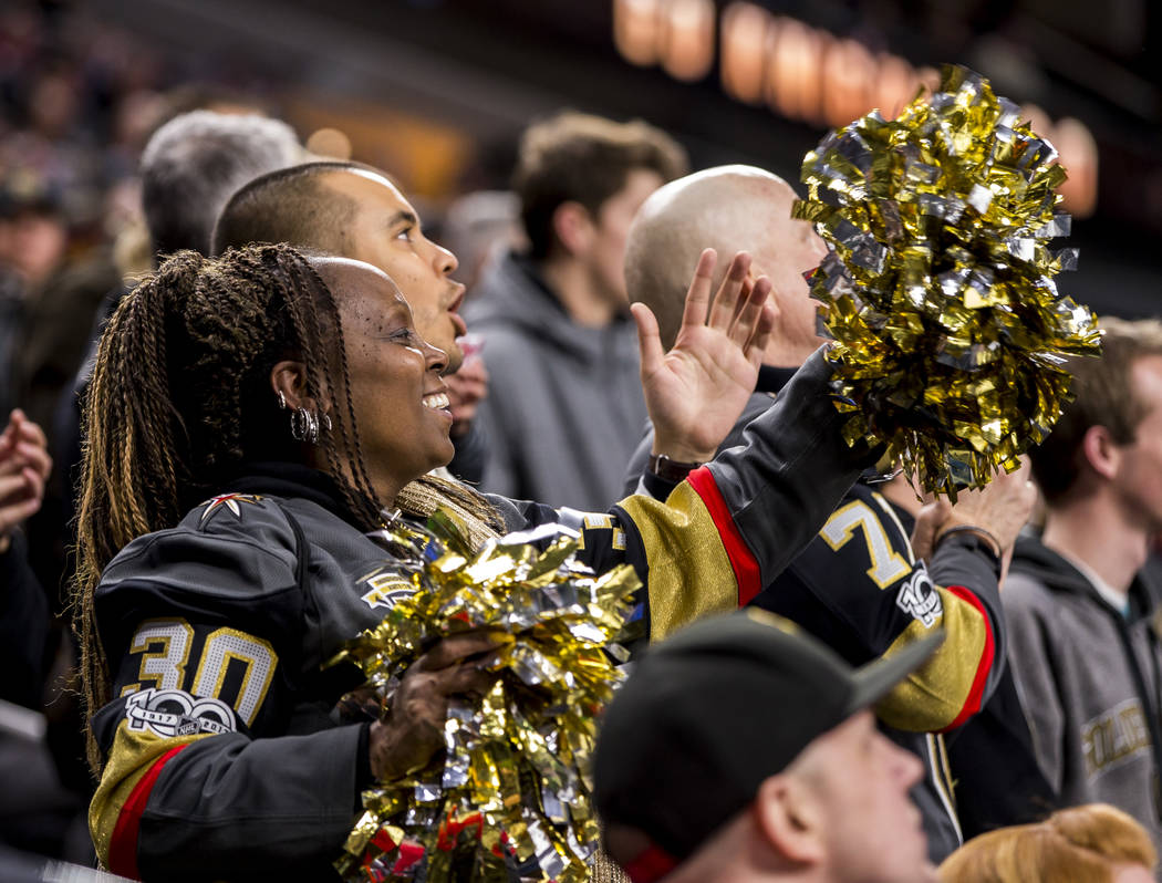 A fan cheers after the Golden Knights' first goal during the first period of an NHL hockey game at T-Mobile Arena in Las Vegas on Friday, Feb. 23, 2018.  Patrick Connolly Las Vegas Review-Journal  ...