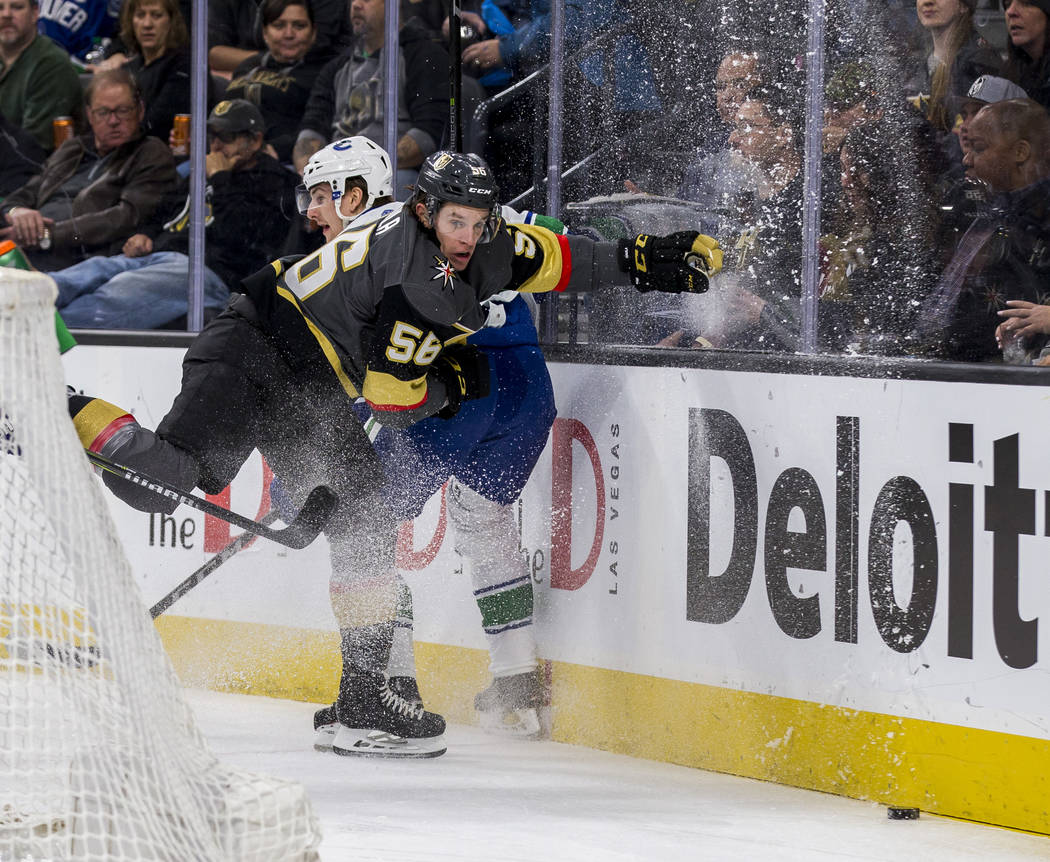Vegas Golden Knights left wing Erik Haula (56) clashes with Vancouver Canucks defenseman Philip Holm (29) during the first period of an NHL hockey game at T-Mobile Arena in Las Vegas on Friday, Fe ...