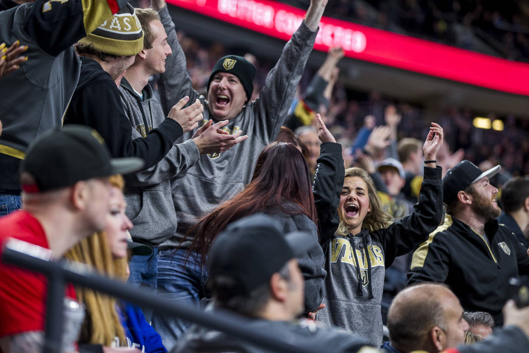 Fans celebrate after the Golden Knights' third goal of the game during the second period of an NHL hockey game at T-Mobile Arena in Las Vegas on Friday, Feb. 23, 2018.  Patrick Connolly Las Vegas  ...