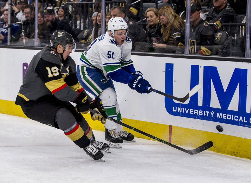 Golden Knights right wing Reilly Smith (19) and Vancouver Canucks defenseman Troy Stecher (51) battle for the puck during the third period of an NHL hockey game at T-Mobile Arena in Las Vegas on F ...
