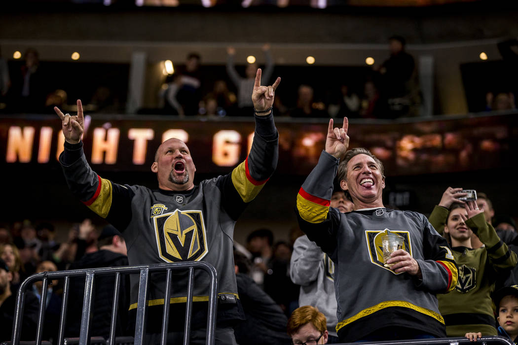 Knights fans celebrate after the sixth Knights goal of the game during the third period of an NHL hockey game at T-Mobile Arena in Las Vegas on Friday, Feb. 23, 2018. The Knights won 6-3.  Patrick ...
