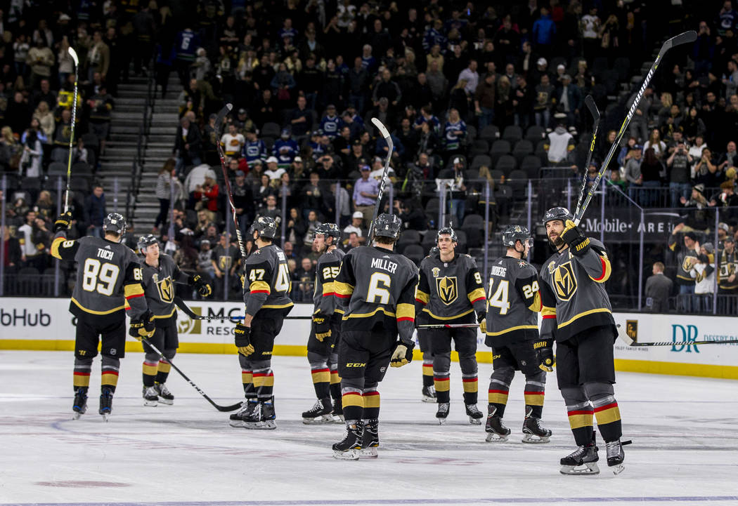 The Golden Knights raise their sticks in victory during the third period of an NHL hockey game at T-Mobile Arena in Las Vegas on Friday, Feb. 23, 2018. The Knights won 6-3.  Patrick Connolly Las V ...
