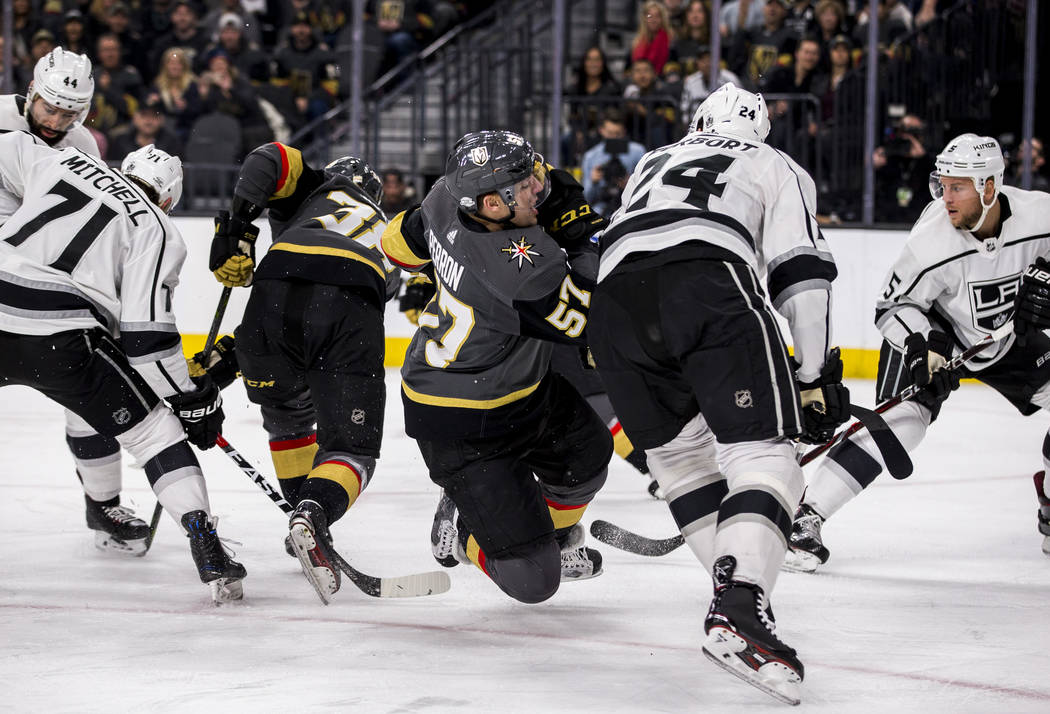 Golden Knights and Los Angeles Kings players get tangled up fighting over the puck during the first period of an NHL hockey game at T-Mobile Arena on Tuesday, Feb. 27, 2018.  Patrick Connolly Las  ...