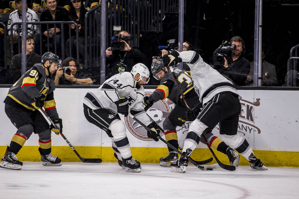 Vegas Golden Knights right wing Tomas Hyka (38) and Los Angeles Kings center Nate Thompson (44) fight over the puck during the first period of an NHL hockey game at T-Mobile Arena on Tuesday, Feb. ...