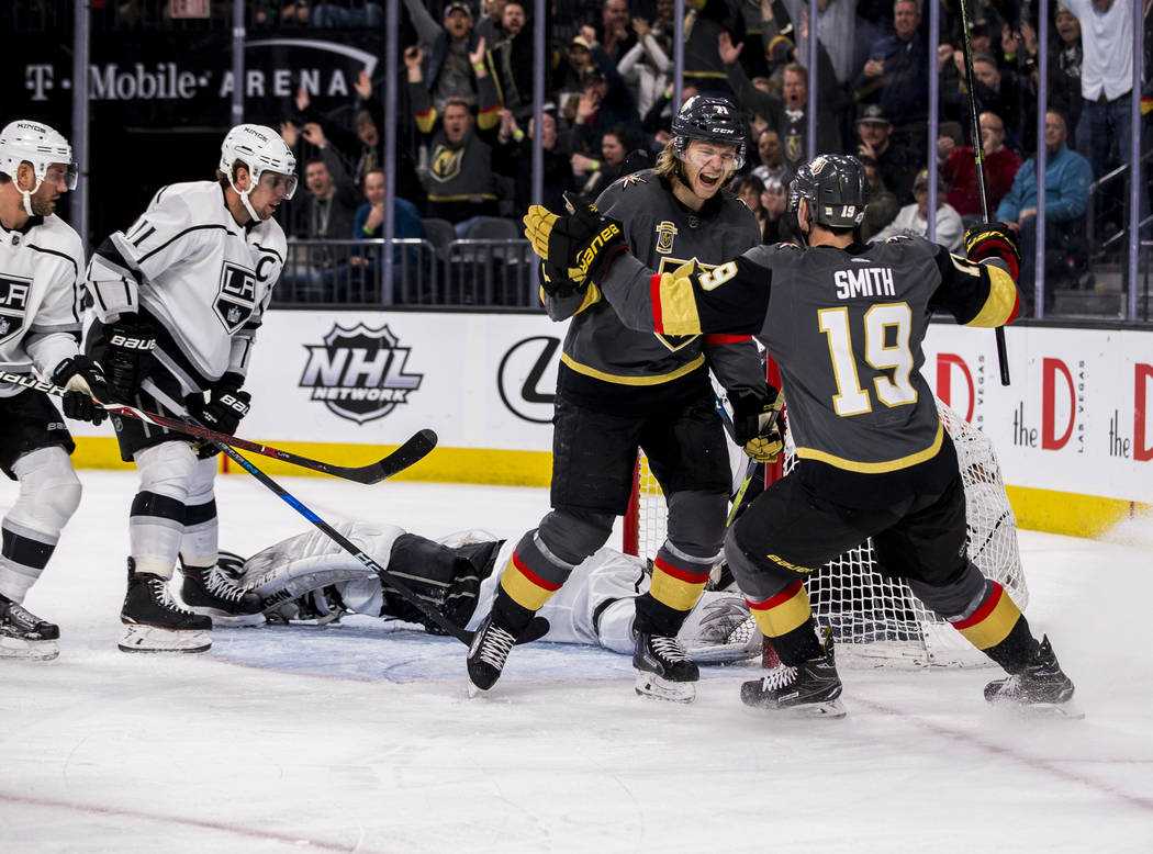 Vegas Golden Knights center William Karlsson (71) and Vegas Golden Knights right wing Reilly Smith (19) celebrate after scoring their first goal against the Los Angeles Kings during the first peri ...
