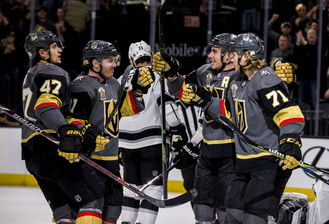 Vegas Golden Knights players celebrate after scoring their first goal against the Los Angeles Kings during the first period of an NHL hockey game at T-Mobile Arena on Tuesday, Feb. 27, 2018.  Patr ...