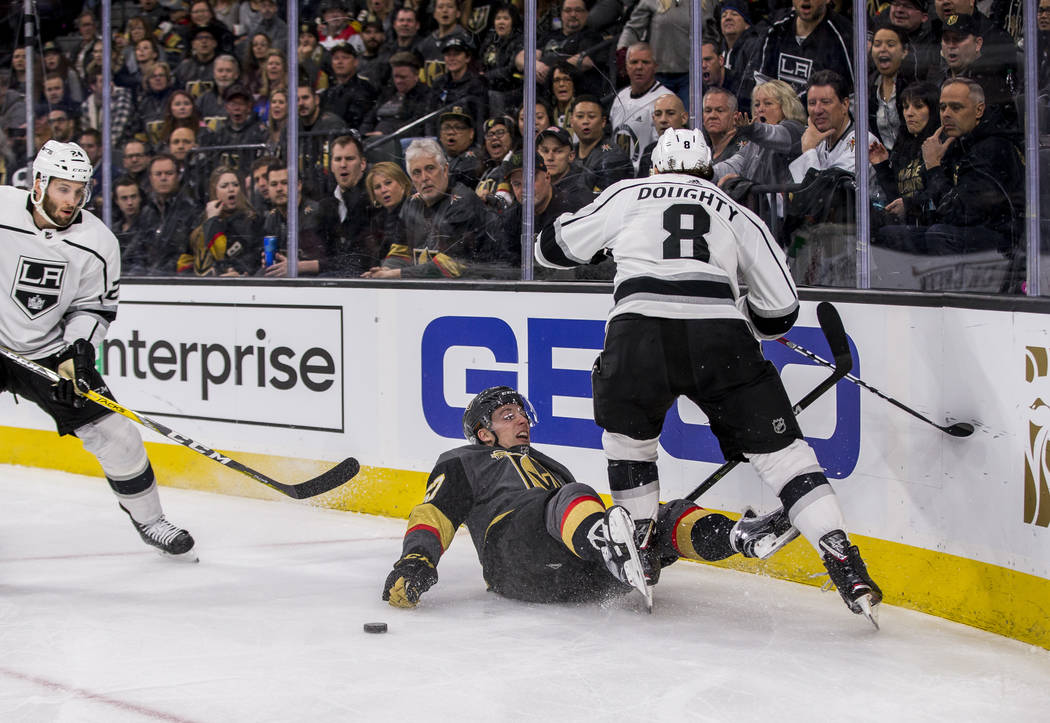 Vegas Golden Knights left wing David Perron (57) gets tripped up next to Los Angeles Kings defenseman Drew Doughty (8) during the first period of an NHL hockey game at T-Mobile Arena on Tuesday, F ...