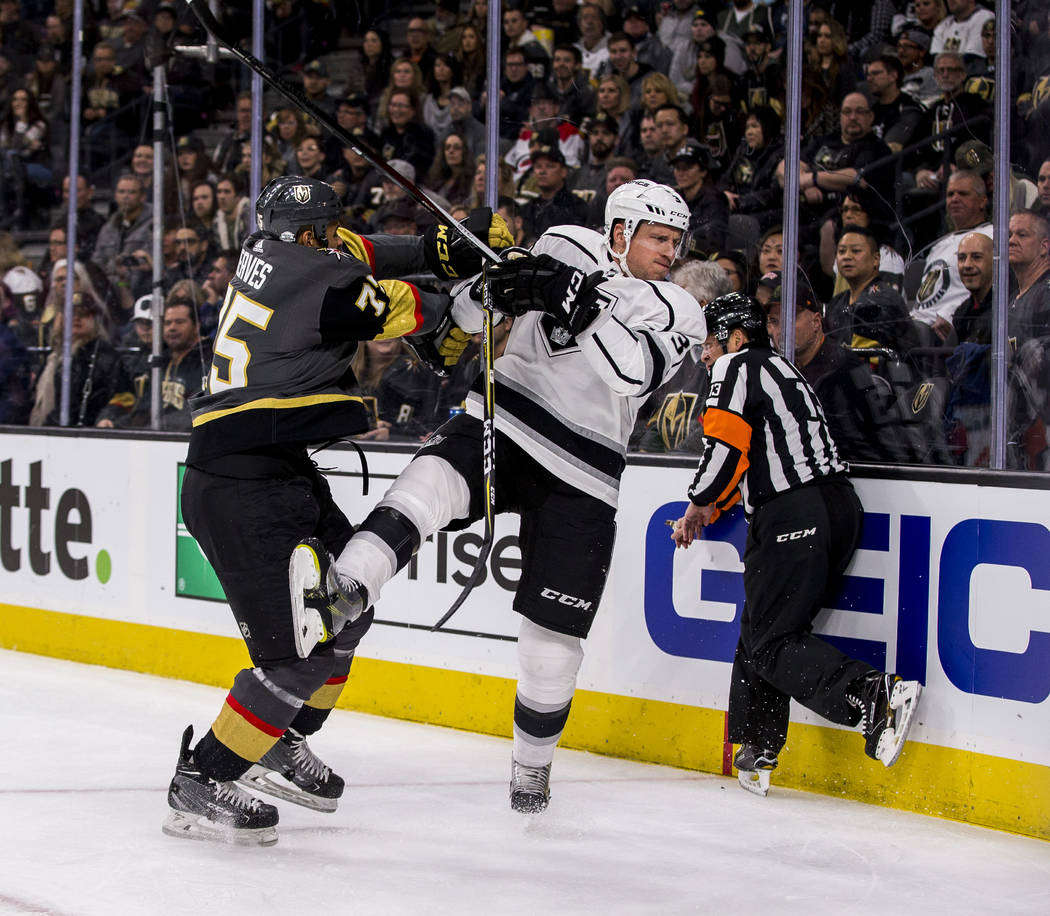 Vegas Golden Knights right wing Ryan Reaves (75) gives Los Angeles Kings defenseman Dion Phaneuf (3) a shove during the first period of an NHL hockey game at T-Mobile Arena on Tuesday, Feb. 27, 20 ...