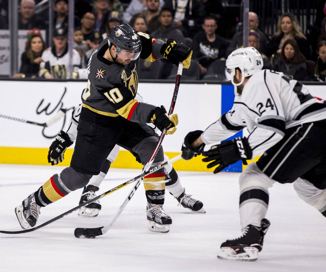 Vegas Golden Knights center Ryan Carpenter (40) tries to make a shot past Los Angeles Kings defenseman Derek Forbort (24) during the first period of an NHL hockey game at T-Mobile Arena on Tuesday ...