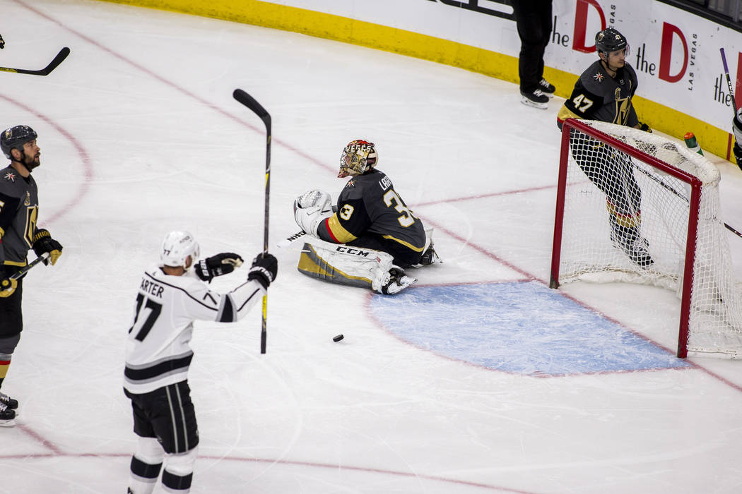 Vegas Golden Knights goaltender Maxime Lagace (33) takes a seat after Los Angeles Kings center Jeff Carter (77) scored the Kings' second goal of the game during the second period of an NHL hockey  ...