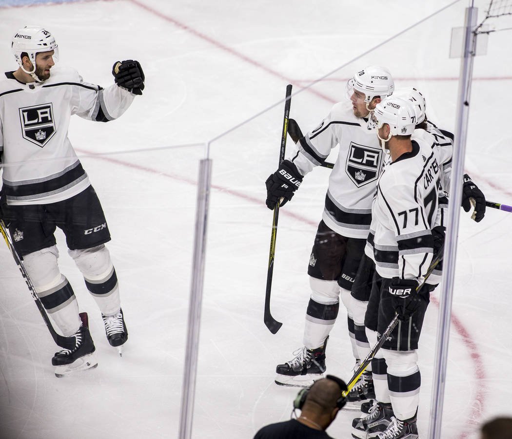 Los Angeles Kings players celebrate after Los Angeles Kings center Tyler Toffoli (73) scored the Kings' second goal of the game during the second period of an NHL hockey game at T-Mobile Arena on  ...