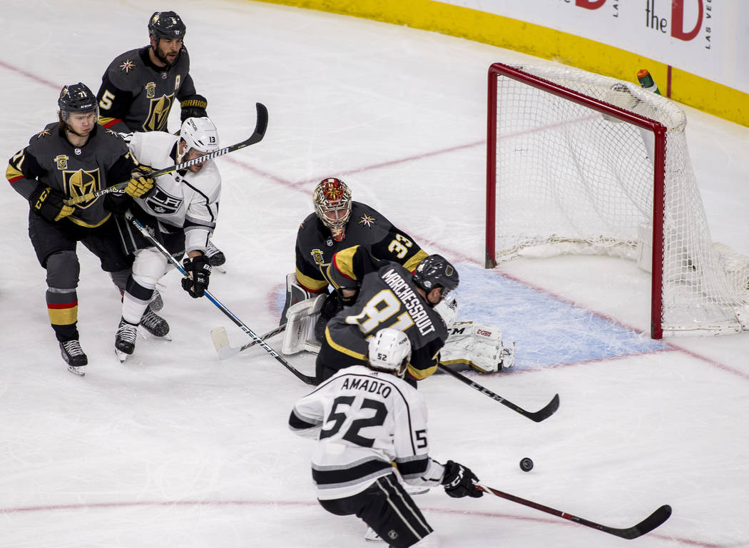 Vegas Golden Knights center Jonathan Marchessault (81) tries to keep the puck away from the Knights' goal while playing against the Los Angeles Kings during the second period of an NHL hockey game ...