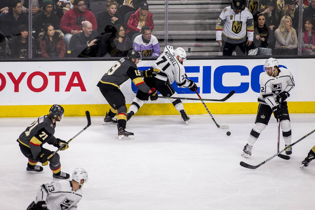 Los Angeles Kings center Torrey Mitchell (71) tries to keep the puck away from Vegas Golden Knights right wing Reilly Smith (19)during the second period of an NHL hockey game at T-Mobile Arena on  ...