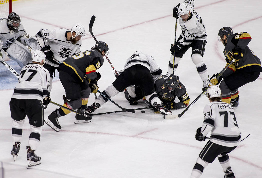 Los Angeles Kings and Golden Knights players get tangled up while fighting for the puck near the Kings' goal during the second period of an NHL hockey game at T-Mobile Arena on Tuesday, Feb. 27, 2 ...