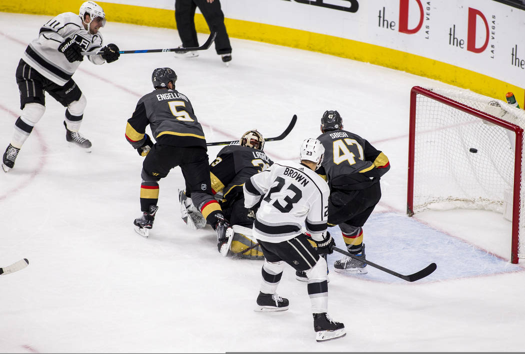 Los Angeles Kings center Anze Kopitar (11) scores the Kings' third goal against the Los Angeles Kings during the second period of an NHL hockey game at T-Mobile Arena on Tuesday, Feb. 27, 2018.  P ...