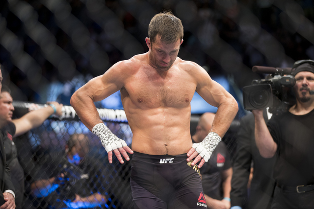 Luke Rockhold reacts to his knockout loss against Michael Bisping in the first round of the UFC 199 middleweight title bout at The Forum on Saturday, June 4, 2016, in Inglewood, Calif. Erik Verduz ...