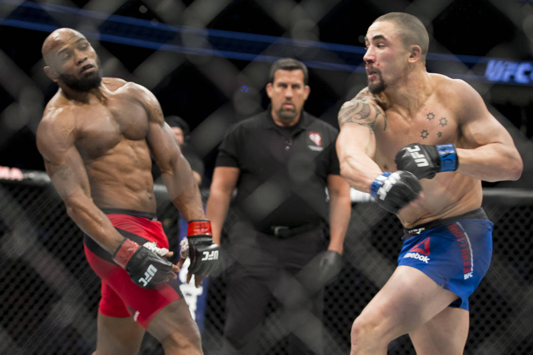 Yoel Romero, left, battles Robert Whittaker in the UFC 213 interim middleweight title bout at T-Mobile Arena in Las Vegas, Saturday, July 8, 2017. Whittaker won by unanimous decision. Erik Verduzc ...