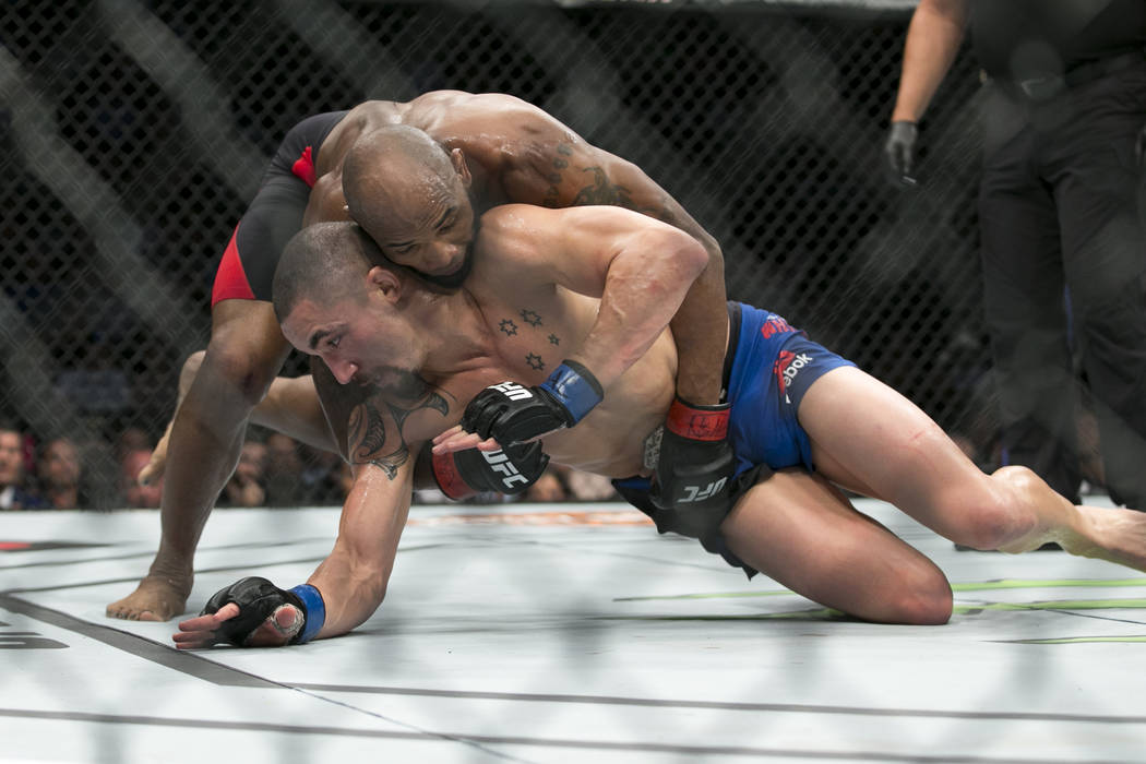 Yoel Romero, top, battles Robert Whittaker in the UFC 213 interim middleweight title bout at T-Mobile Arena in Las Vegas, Saturday, July 8, 2017. Whittaker won by unanimous decision. Erik Verduzco ...
