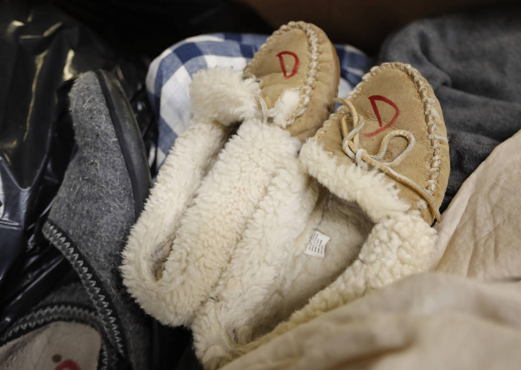 In this Friday, Feb. 2, 2018 photo slippers that were returned to the L.L. Bean retail store in Freeport, Maine are marked to prevent future returns. Much of L.L. Bean's returns are donated to Goo ...
