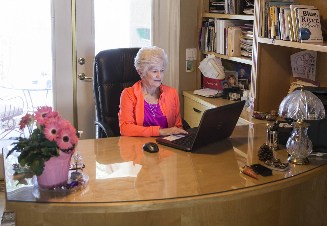 Writer/advocate Nancy Nelson, 74, works on a poem in her office on Monday, February 5, 2018, in Las Vegas. Nelson was diagnosed with early onset Alzheimerճ disease in 2013, and attributes mu ...