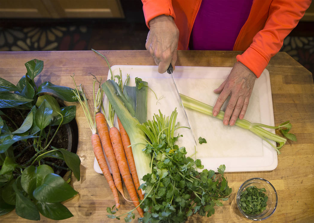Writer/advocate Nancy Nelson, 74, cuts fresh vegetables for chicken soup on Monday, February 5, 2018, at Nelson's home, in Las Vegas. Nelson was diagnosed with early onset Alzheimerճ disease ...
