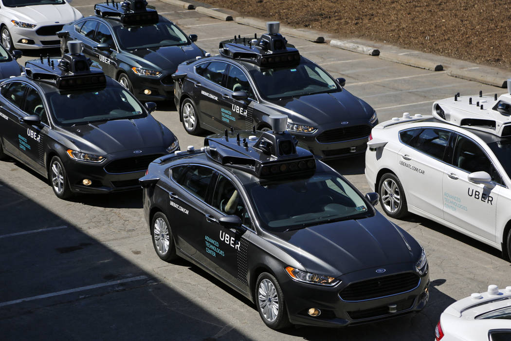 A group of self driving Uber vehicles position themselves to take journalists on rides during a media preview at Uber's Advanced Technologies Center in Pittsburgh. (AP Photo/Gene J. Puskar, File)