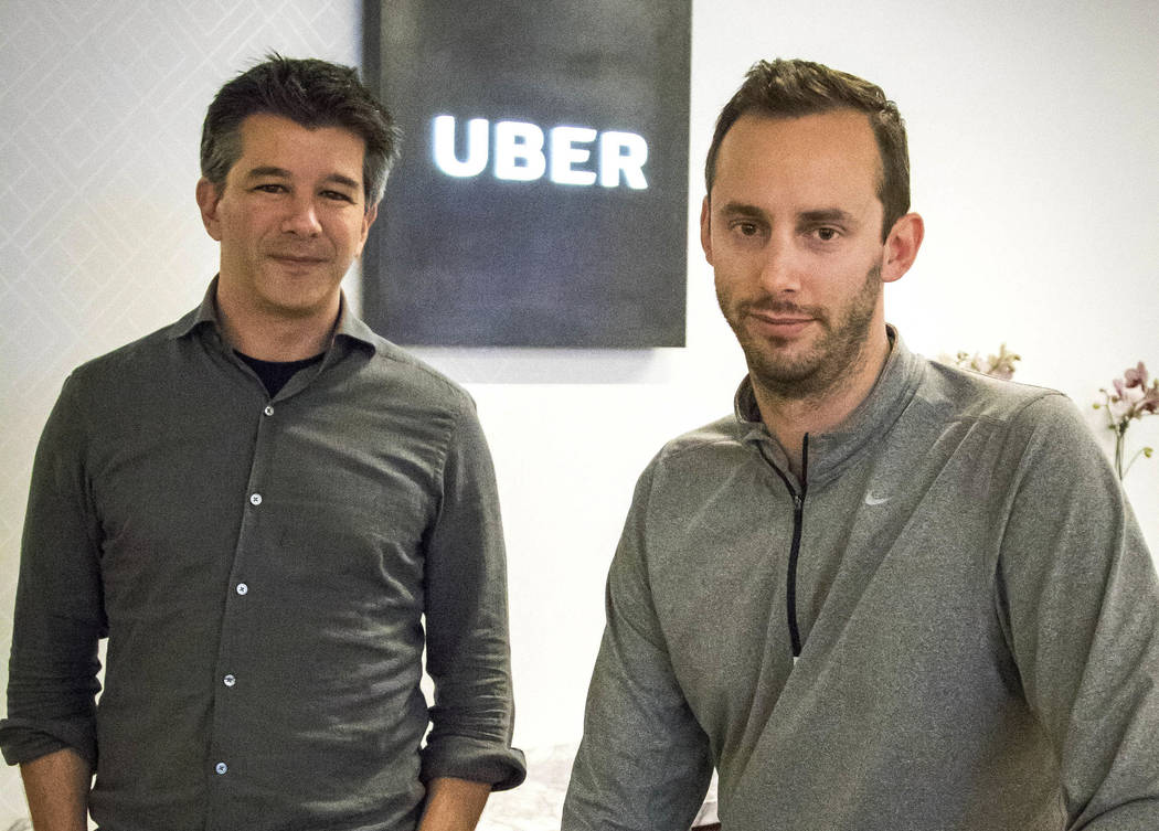 Uber CEO Travis Kalanick, left, and Anthony Levandowski, co-founder of Otto, pose for a photo in the lobby of Uber headquarters in San Francisco. (AP Photo/Tony Avelar, File)