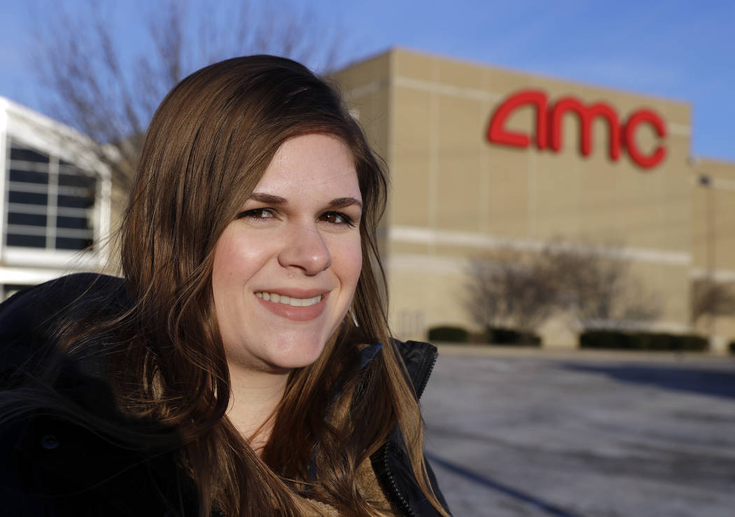 Cassie Langdon stands outside of AMC Indianapolis 17 theatre in Indianapolis, Tuesday, Jan. 30, 2018. With MoviePass, Langdon said she's taking more chances on smaller releases instead of sticking ...