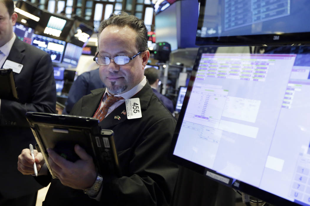 Trader Robert Arciero works on the floor of the New York Stock Exchange, Friday, Feb. 9, 2018. U.S. stocks wavered between small gains and losses in morning trading Friday, giving up some of a big ...